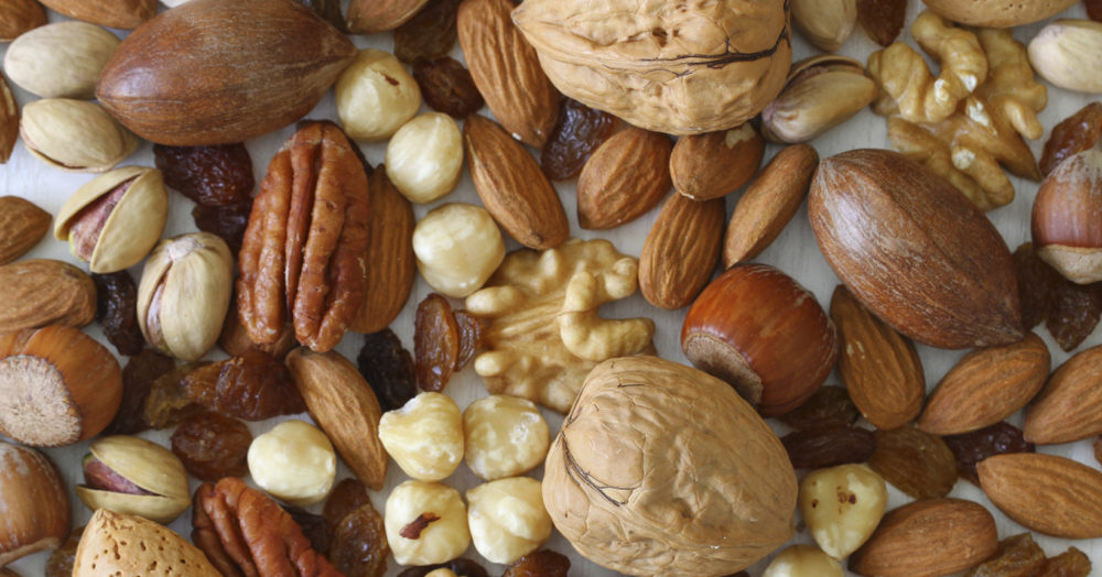 Selecion of nuts, almonds and sultanas, close up